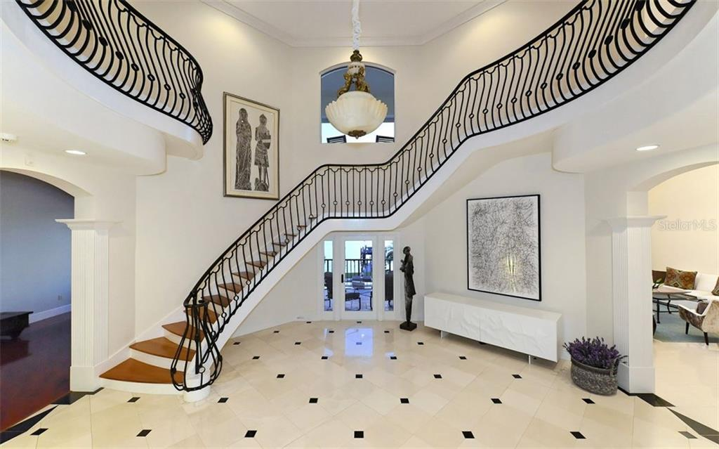 Exquisite foyer featuring the grand staircase & chandelier. - Single Family Home for sale at 2145 Alameda Ave, Sarasota, FL 34234 - MLS Number is A4414337