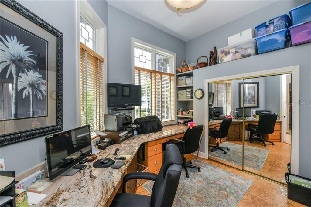 One bedroom being used as a business office. - Single Family Home for sale at 1483 Tangier Way, Sarasota, FL 34239 - MLS Number is A4414757