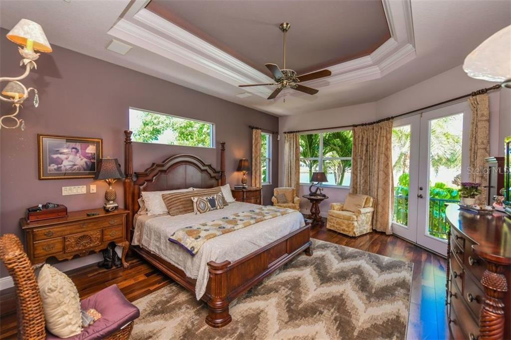 Master bedroom with French doors to pool and fenced yard. - Single Family Home for sale at 1483 Tangier Way, Sarasota, FL 34239 - MLS Number is A4414757