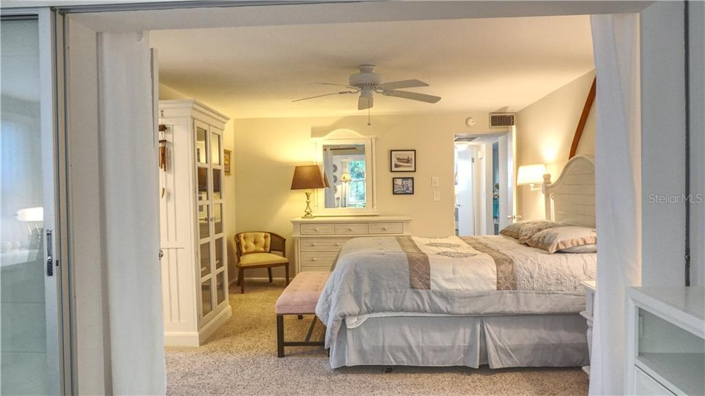 Airy Master bedroom. - Villa for sale at 682 Spanish Dr S, Longboat Key, FL 34228 - MLS Number is A4414905
