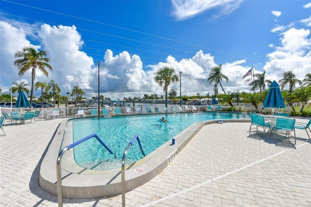 Community pool on the harbor. - Villa for sale at 682 Spanish Dr S, Longboat Key, FL 34228 - MLS Number is A4414905