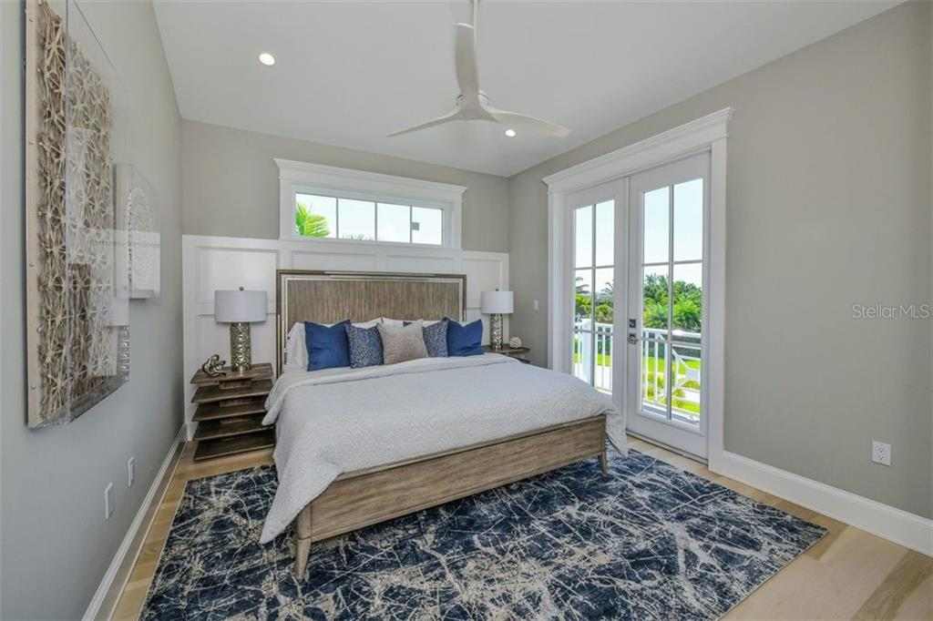 Bedroom 5 on level 3 with deck. - Single Family Home for sale at 3470 Gulf Of Mexico Dr, Longboat Key, FL 34228 - MLS Number is A4415298