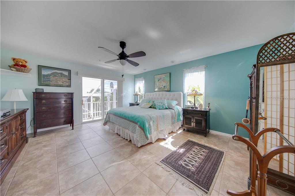 The master bedroom on the 3rd floor has it's own private screened in deck that overlooks the lower level decks and the pool and canal. - Single Family Home for sale at 660 Marbury Ln, Longboat Key, FL 34228 - MLS Number is A4415911