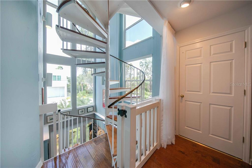 The staircase from the 2nd floor. The door is the elevator. Large, light filled windows. - Single Family Home for sale at 660 Marbury Ln, Longboat Key, FL 34228 - MLS Number is A4415911