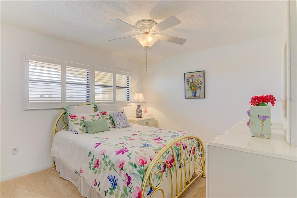 Guest Bedroom 2 - Condo for sale at 8750 Midnight Pass Rd #502c, Siesta Key, FL 34242 - MLS Number is A4416020