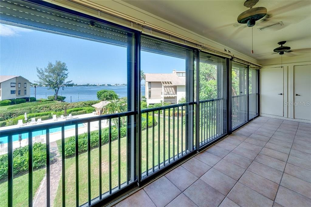 Plenty of room on the enclosed lanai with gorgeous Palma Sola Bay views. - Condo for sale at 3920 Mariners Way #323a, Cortez, FL 34215 - MLS Number is A4416115