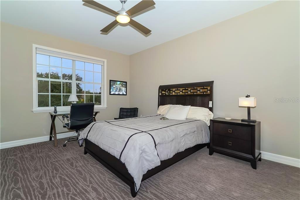 Second Level Guest Room 1 - Single Family Home for sale at 7698 Albert Tillinghast Dr, Sarasota, FL 34240 - MLS Number is A4416123