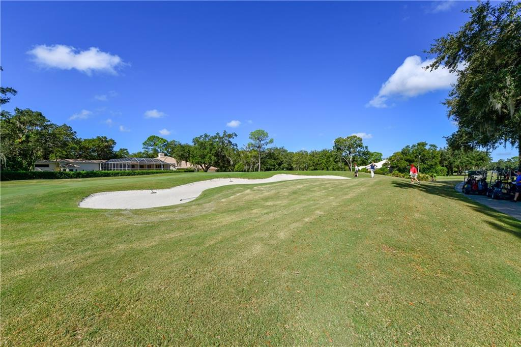 View of the golf course from the property - Single Family Home for sale at 7659 Alister Mackenzie Dr, Sarasota, FL 34240 - MLS Number is A4416607