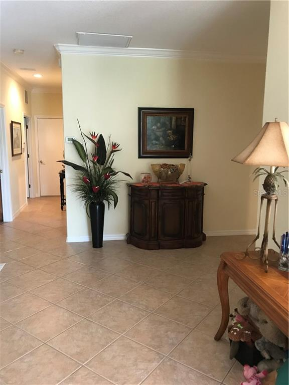 View toward ... second bedroom and garage. - Villa for sale at 252 Fairway Isles Ln, Bradenton, FL 34212 - MLS Number is A4417217