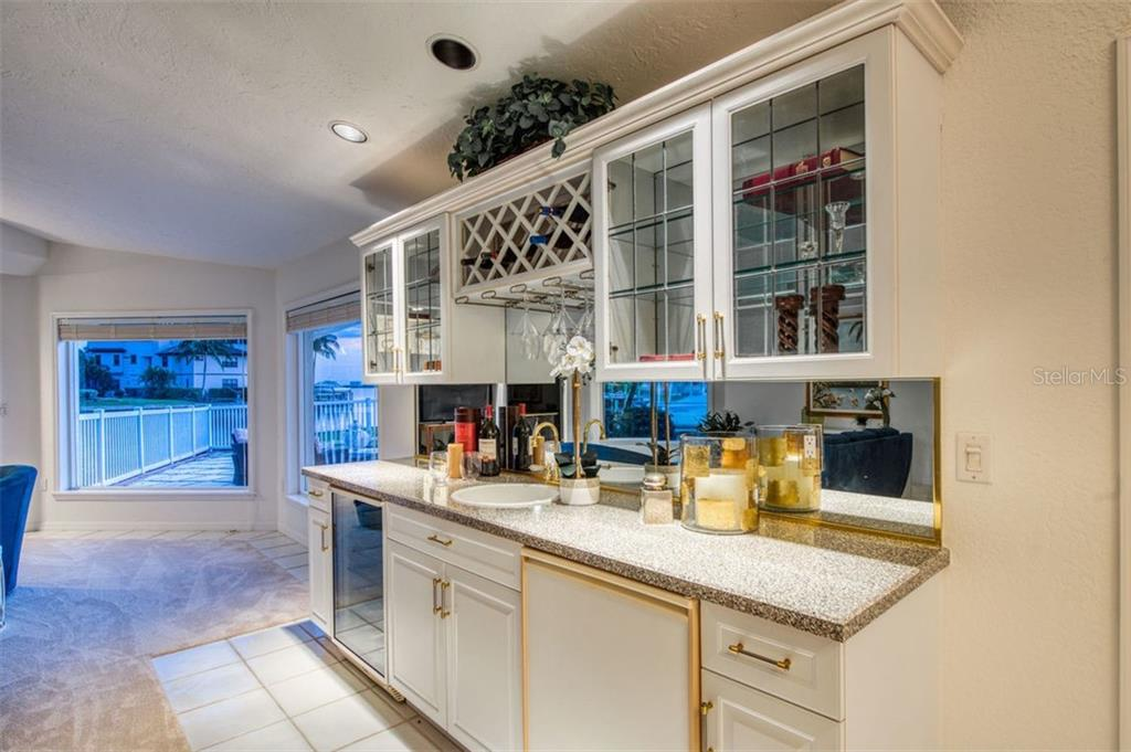 Family room wet bar, adjacent to pool/lanai area for entertaining convenience. - Single Family Home for sale at 7689 Cove Ter, Sarasota, FL 34231 - MLS Number is A4417242