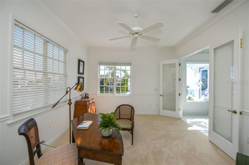 Upper level office/den - Single Family Home for sale at 7689 Cove Ter, Sarasota, FL 34231 - MLS Number is A4417242