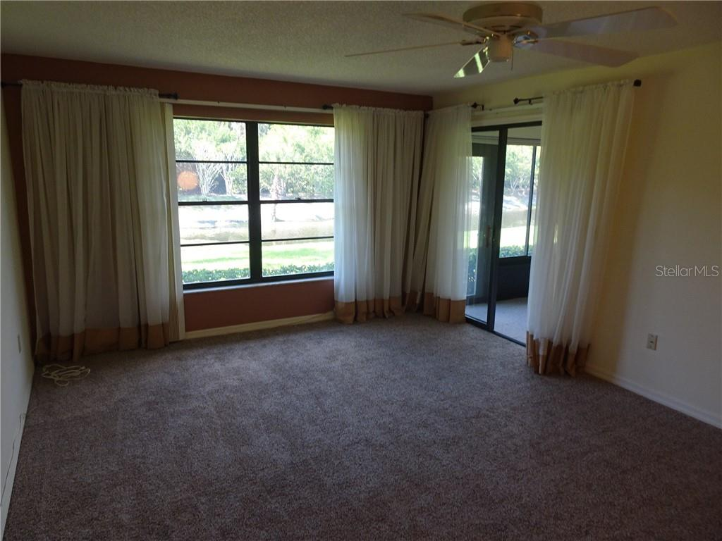 Spacious master bedroom overlooking waterway and sliding door to enclosed lanai. - Villa for sale at 3617 Gleneagle Dr, Sarasota, FL 34238 - MLS Number is A4417832