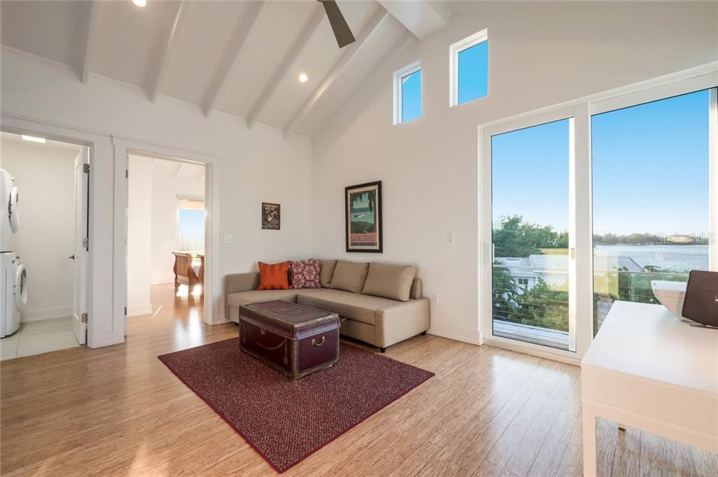 Family room - Single Family Home for sale at 7130 Longboat Dr E, Longboat Key, FL 34228 - MLS Number is A4418105