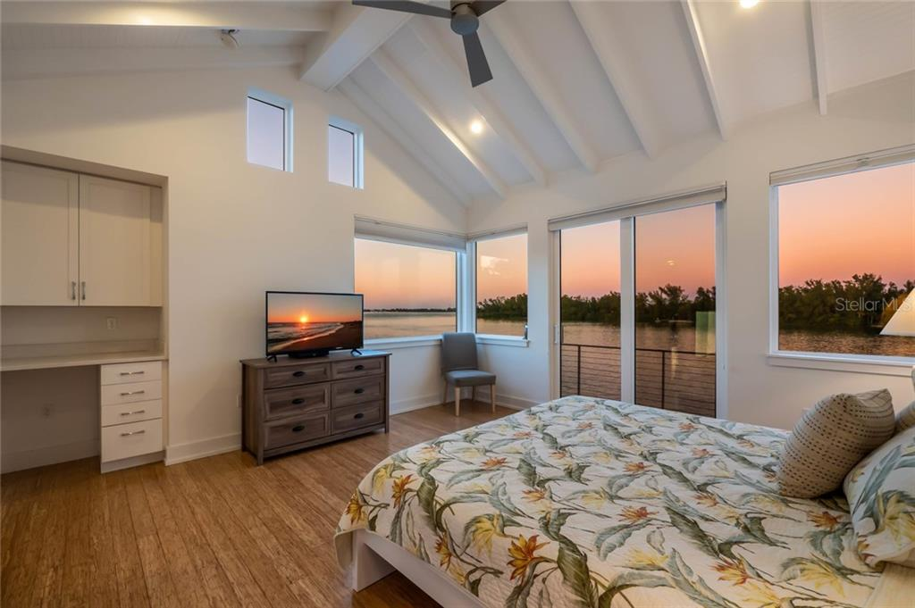 Master bedroom at twilight - Single Family Home for sale at 7130 Longboat Dr E, Longboat Key, FL 34228 - MLS Number is A4418105