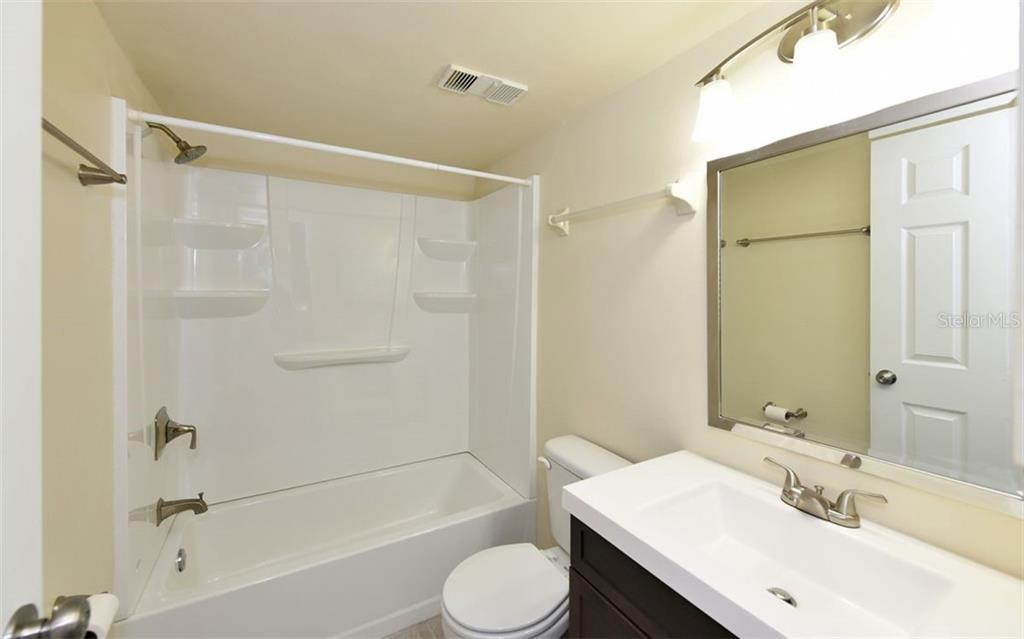 Updated Guest Bathroom - Condo for sale at 4576 Longwater Chase #59, Sarasota, FL 34235 - MLS Number is A4418168