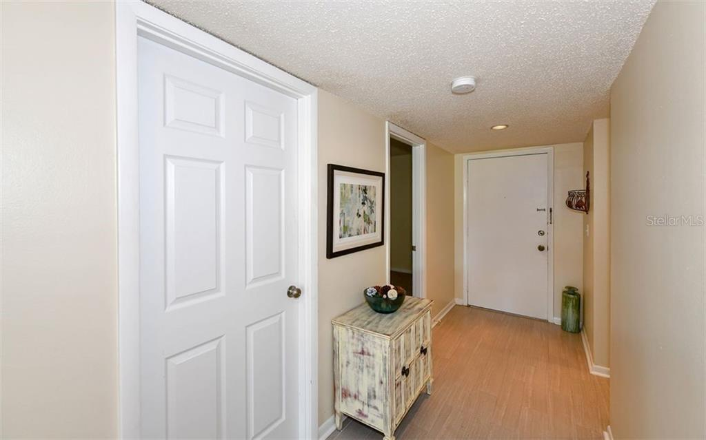 Inviting Foyer - Condo for sale at 4576 Longwater Chase #59, Sarasota, FL 34235 - MLS Number is A4418168