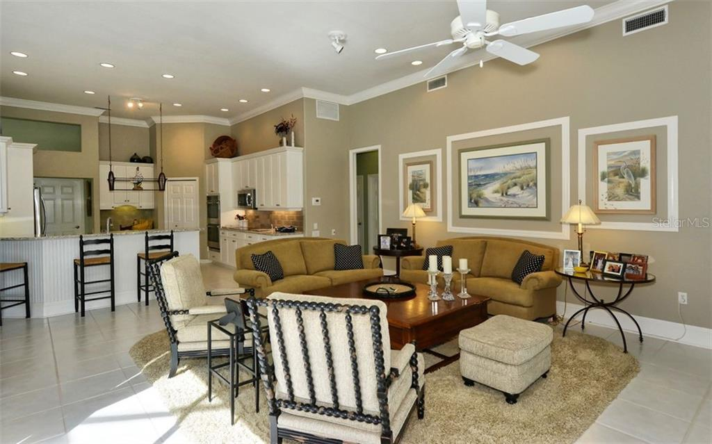 Family room to kitchen - Single Family Home for sale at 462 Sherbrooke Ct, Venice, FL 34293 - MLS Number is A4418225