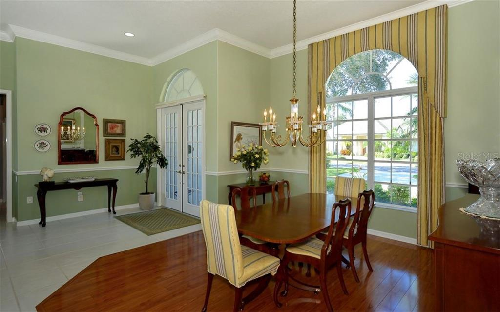 Dining room to foyer - Single Family Home for sale at 462 Sherbrooke Ct, Venice, FL 34293 - MLS Number is A4418225