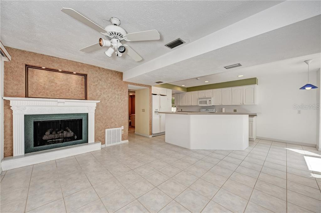 FAMILY ROOM - with POOL/LANAI ACCESS, FIREPLACE & WATER VIEWS - Single Family Home for sale at 5110 Sun Cir, Sarasota, FL 34234 - MLS Number is A4420424