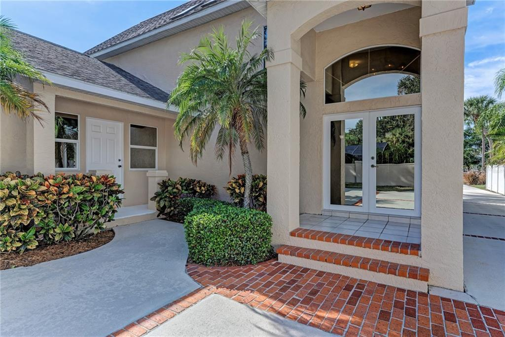 MAIN & SECONDARY ENTRANCES - Single Family Home for sale at 5110 Sun Cir, Sarasota, FL 34234 - MLS Number is A4420424