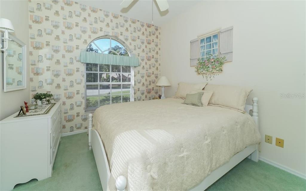 Guest bedroom. - Single Family Home for sale at 6125 Varedo Ct, Sarasota, FL 34243 - MLS Number is A4420656