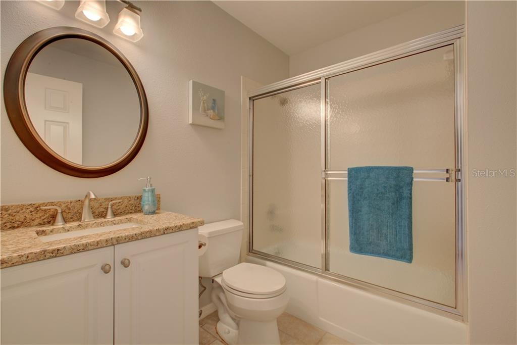 3rd full Bathroom with granite countertop - Single Family Home for sale at 5167 Kestral Park Ln, Sarasota, FL 34231 - MLS Number is A4421162