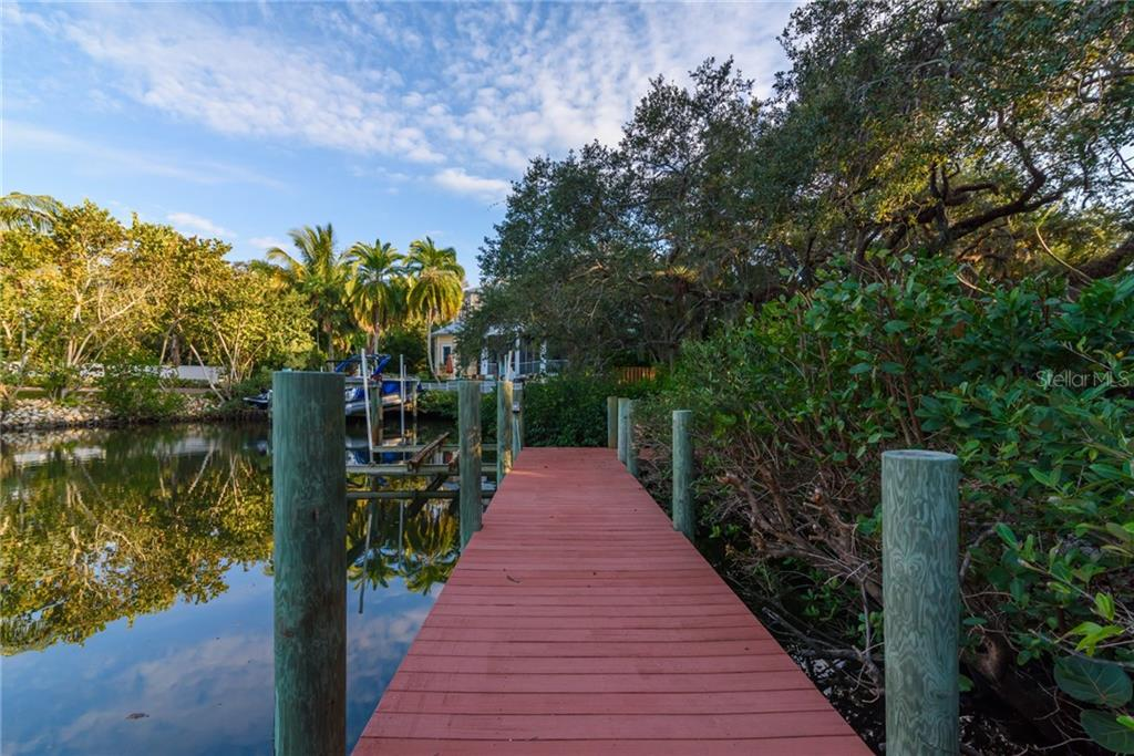 34' Composite Dock and Lift  replaced approx 6 years ago - Single Family Home for sale at 5303 Hidden Harbor Rd, Sarasota, FL 34242 - MLS Number is A4421223