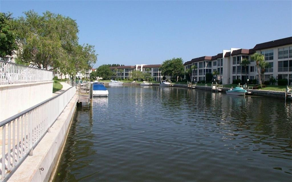 Berths and canal surrounding the community - Condo for sale at 4370 Chatham Dr #204, Longboat Key, FL 34228 - MLS Number is A4421600