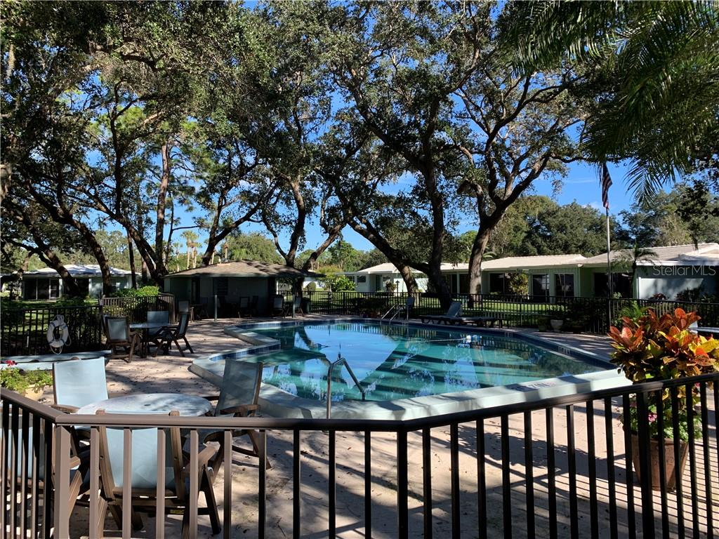 Community pool area - Villa for sale at 1528 Stafford Ln #1210, Sarasota, FL 34232 - MLS Number is A4421860