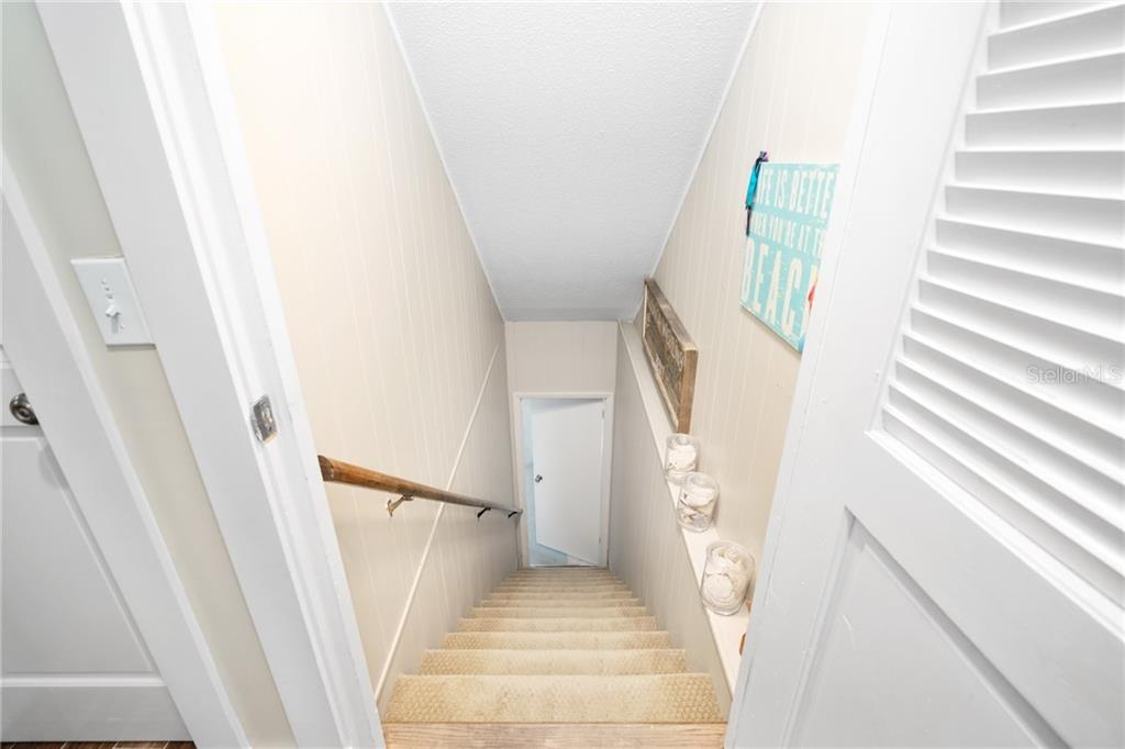 Stairway between First Floor and Second Floor - Single Family Home for sale at 107 Willow Ave, Anna Maria, FL 34216 - MLS Number is A4421946