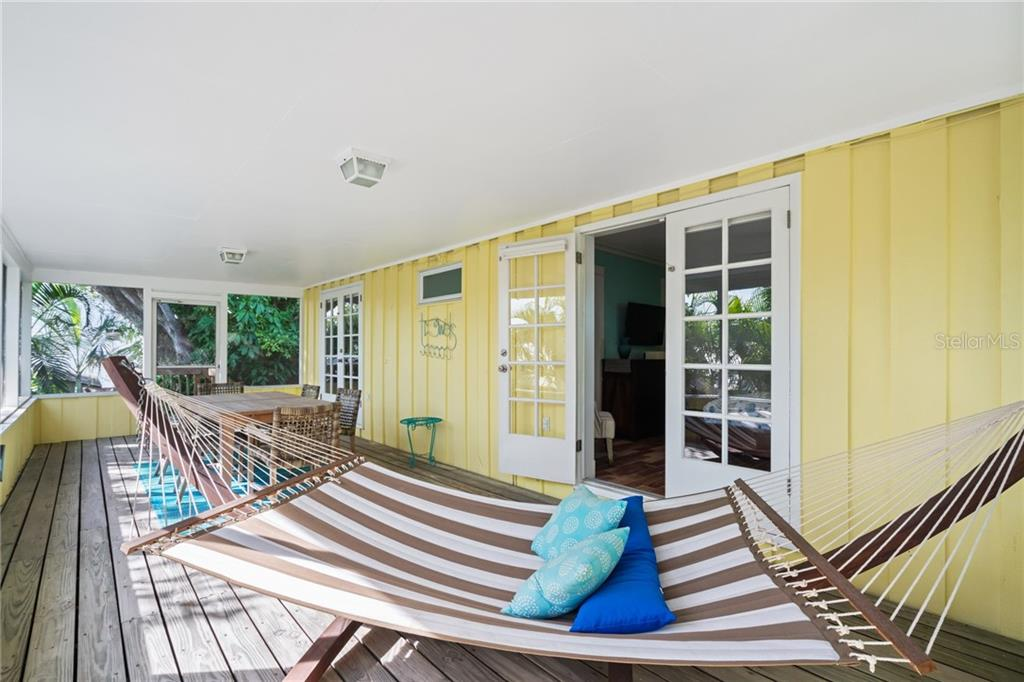 Second Floor Screened In Back Lanai Hammocks - Single Family Home for sale at 107 Willow Ave, Anna Maria, FL 34216 - MLS Number is A4421946