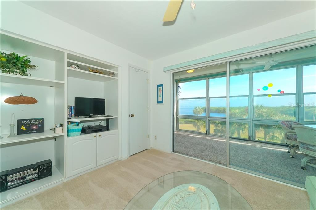Lanai is over 20' feet long and can be accessed from both bedrooms. Perfect for enjoying nature or using as an additional gathering/sleeping space. - Condo for sale at 4700 Gulf Of Mexico Dr #305, Longboat Key, FL 34228 - MLS Number is A4422164