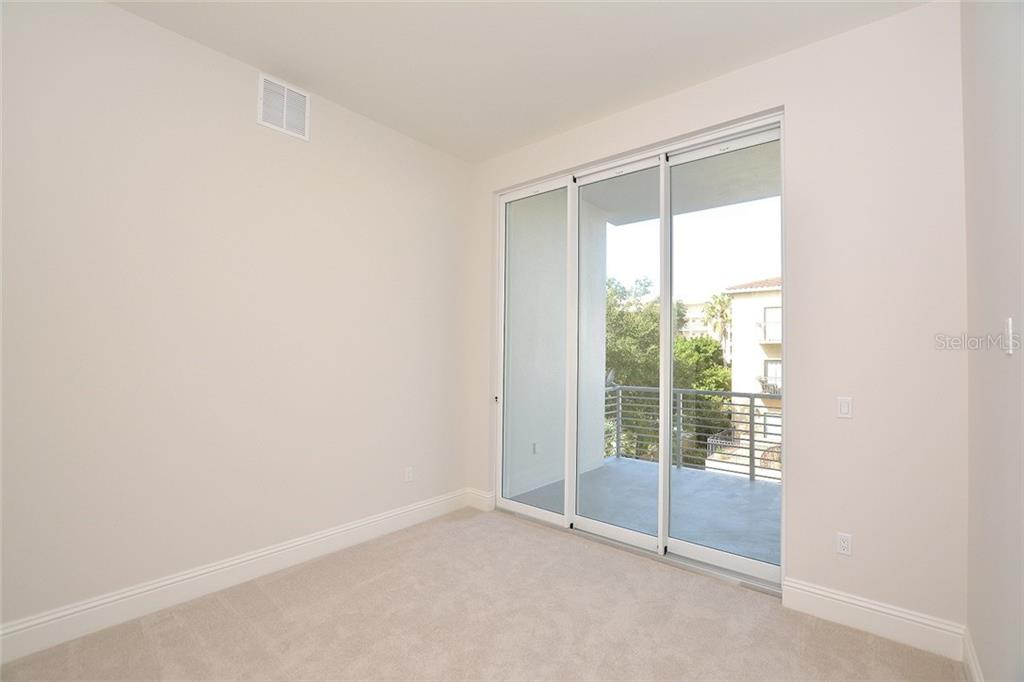 Bedroom 3 with terrace and private ensuite bath. - Condo for sale at 609 Golden Gate Pt #301, Sarasota, FL 34236 - MLS Number is A4422419