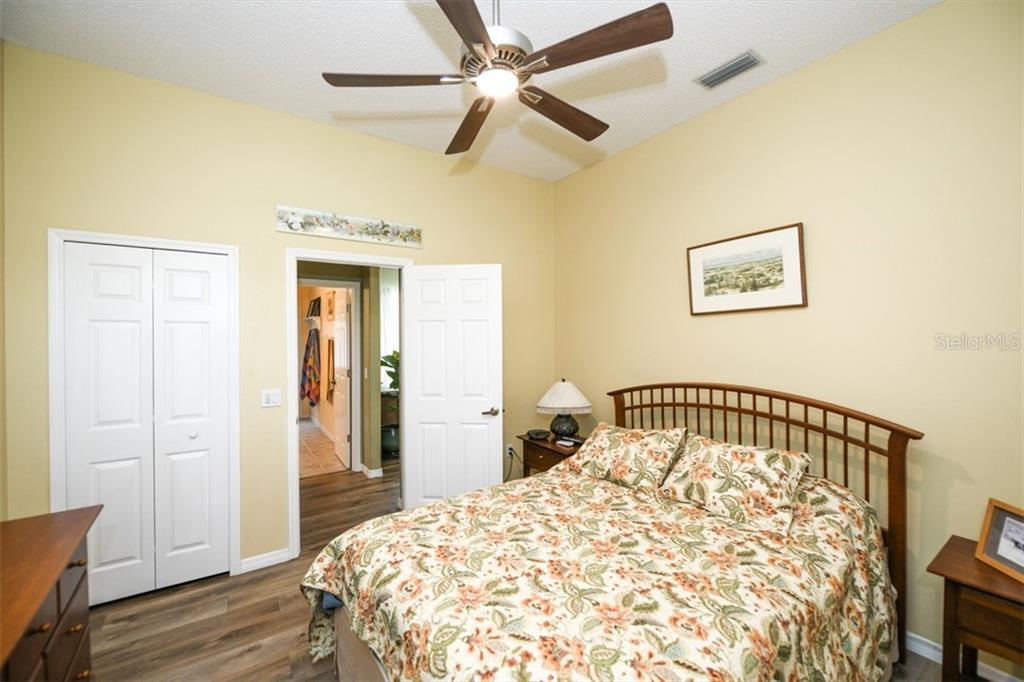 4th bedroom looking toward 3rd bath and family room - Single Family Home for sale at 6161 Varedo Ct, Sarasota, FL 34243 - MLS Number is A4422883
