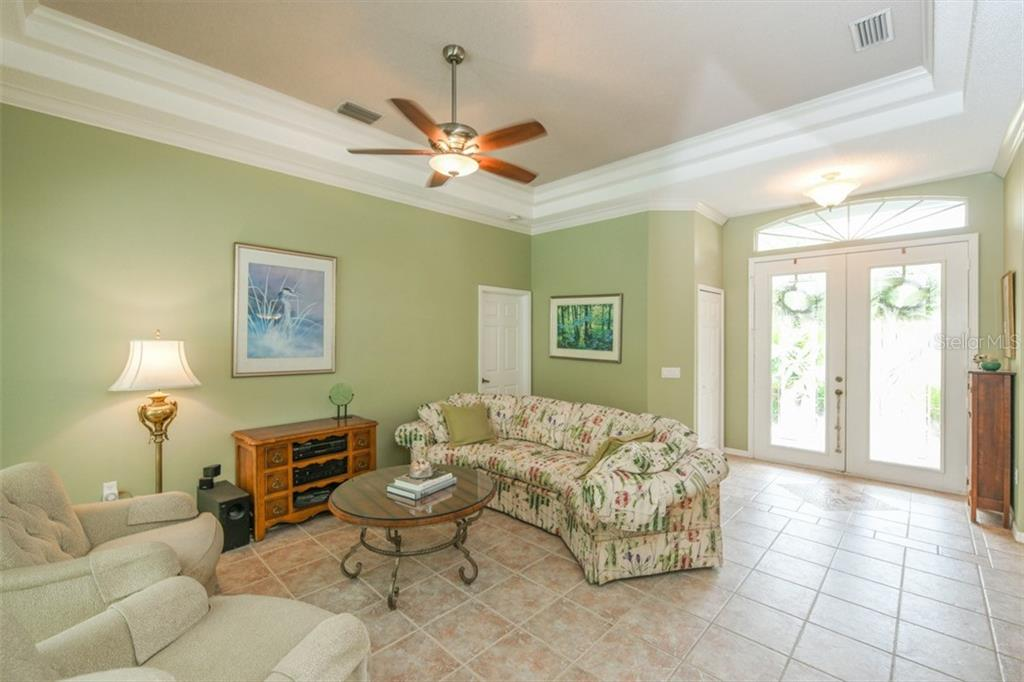 Living Room - Single Family Home for sale at 6161 Varedo Ct, Sarasota, FL 34243 - MLS Number is A4422883