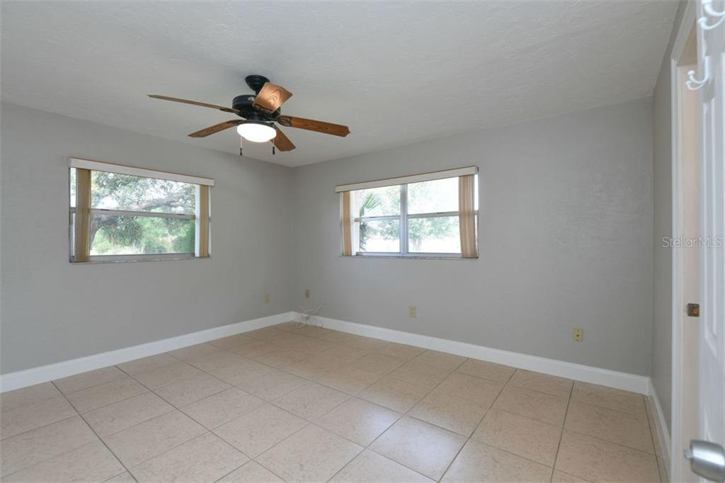 Master bedroom. - Villa for sale at 3434 Medford Ln #1110, Sarasota, FL 34239 - MLS Number is A4422897