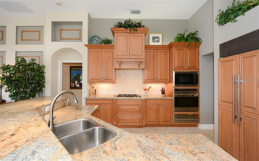 Tastefully updated kitchen with SubZero refrigerator, all other appliances are Wolf - Single Family Home for sale at 2522 Tom Morris Dr, Sarasota, FL 34240 - MLS Number is A4423908
