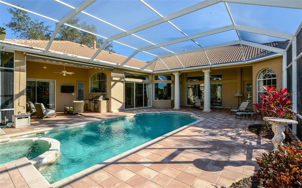 Summer Kitchen features sink, refrigerator, and built in grill. - Single Family Home for sale at 2522 Tom Morris Dr, Sarasota, FL 34240 - MLS Number is A4423908