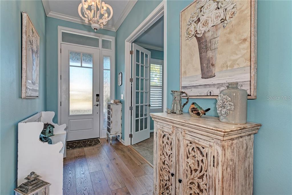 The entryway is warm and inviting! - Single Family Home for sale at 5260 Bentgrass Way, Bradenton, FL 34211 - MLS Number is A4424484