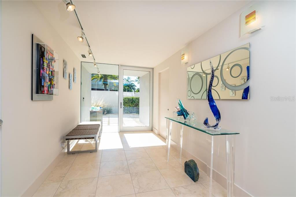 Open, Bright and Modern front Foyer with Hurricane-grade windows and sliders throughout the home. - Single Family Home for sale at 509 Venice Ln, Sarasota, FL 34242 - MLS Number is A4425092