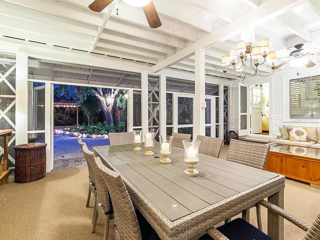 Screened porch at dusk - Single Family Home for sale at 422 Garfield Dr, Sarasota, FL 34236 - MLS Number is A4425287