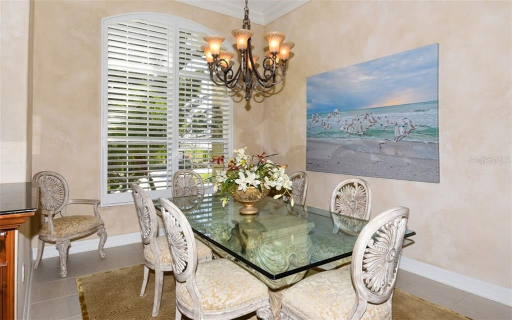 Formal Dining Room with custom painting - Single Family Home for sale at 561 Ketch Ln, Longboat Key, FL 34228 - MLS Number is A4426280