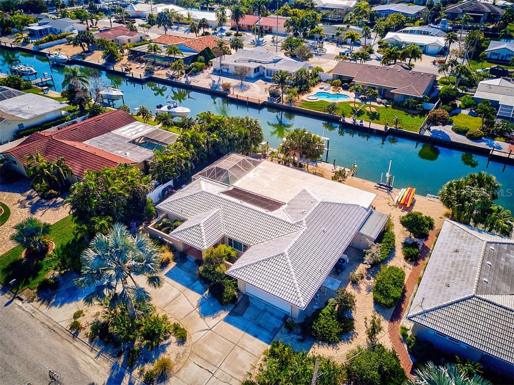 Aerial of top of the house with canal views - Single Family Home for sale at 622 Dundee Ln, Holmes Beach, FL 34217 - MLS Number is A4426329