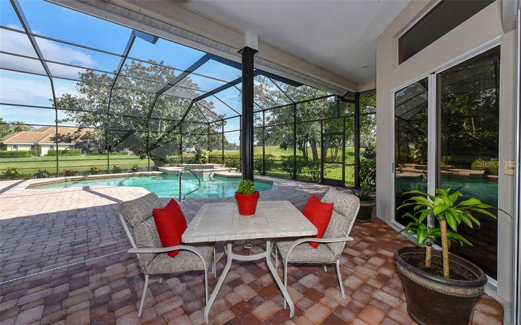 Large pool/spa area with screen cage and plenty of room for entertaining - Single Family Home for sale at 7867 Estancia Way, Sarasota, FL 34238 - MLS Number is A4426528