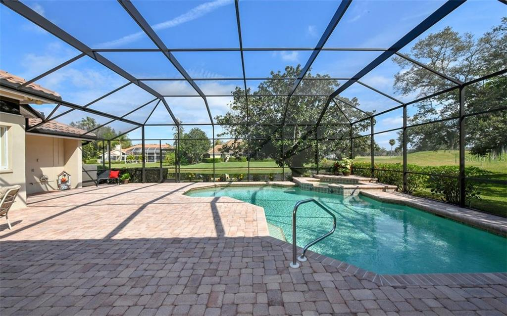 Pool/spa view with lake and view of the golf course - Single Family Home for sale at 7867 Estancia Way, Sarasota, FL 34238 - MLS Number is A4426528