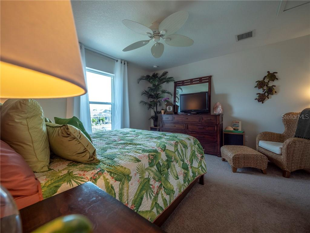 Guest bedroom overlooking pool with views down the canal - Single Family Home for sale at 3611 4th Ave Ne, Bradenton, FL 34208 - MLS Number is A4426978