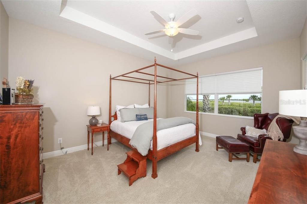 Master bedroom with beautiful water views and tray ceiling - Single Family Home for sale at 5504 Tidewater Preserve Blvd, Bradenton, FL 34208 - MLS Number is A4429479