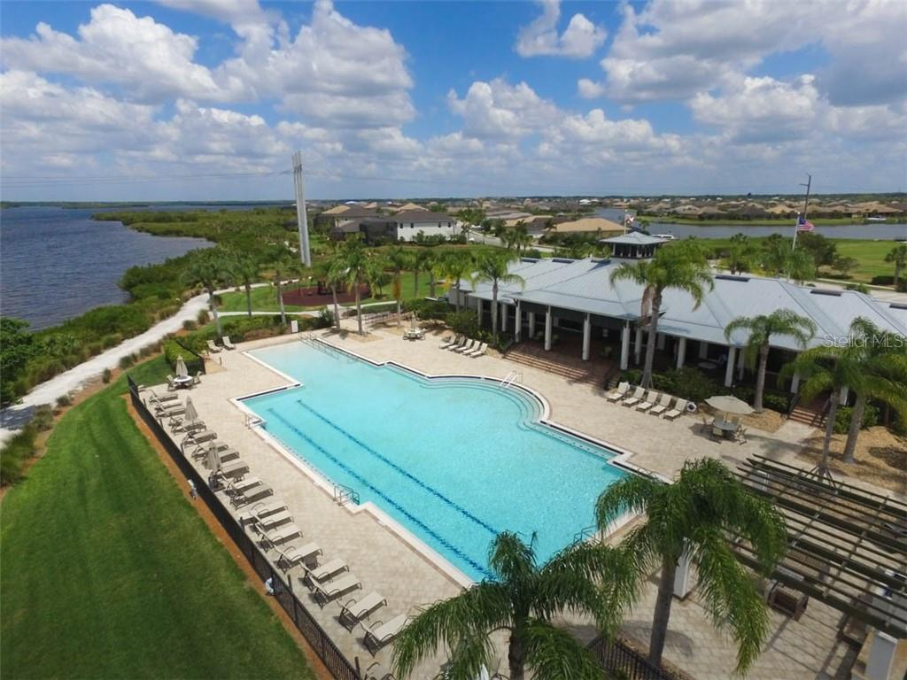 Riverfront amenities: The Lodge with fitness center, gas fireplaces & grill, nature trail to dock on river, playground and dog park - Single Family Home for sale at 5504 Tidewater Preserve Blvd, Bradenton, FL 34208 - MLS Number is A4429479