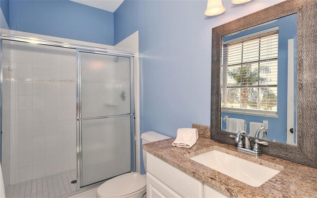 4th bedrooms's private full sized bath with solid wood cabinetry and granite countertops - Single Family Home for sale at 1636 Liscourt Dr, Venice, FL 34292 - MLS Number is A4429524