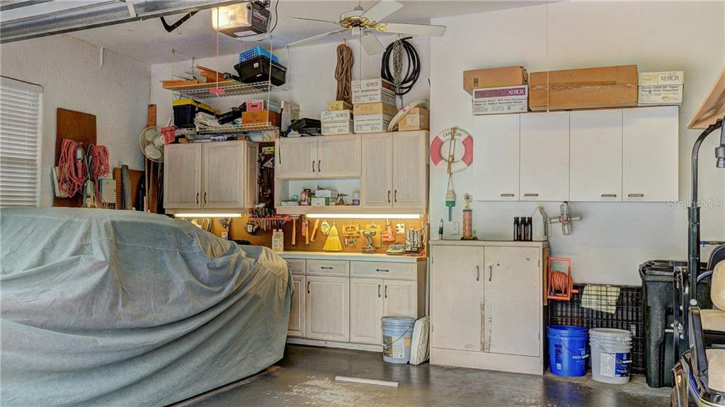 Lighted workshop in the oversized garage with tons of storage - Single Family Home for sale at 6321 W Glen Abbey Ln E, Bradenton, FL 34202 - MLS Number is A4429610